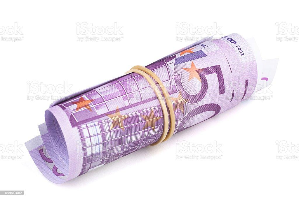 500 Euro rolled up on white background stock photo