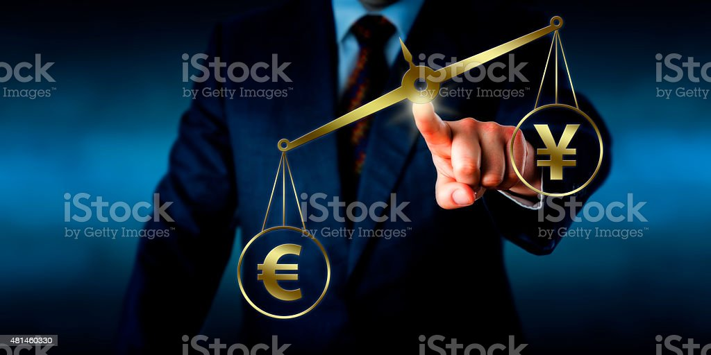 Euro Sign Outweighing The Yuan On A Golden Scale stock photo