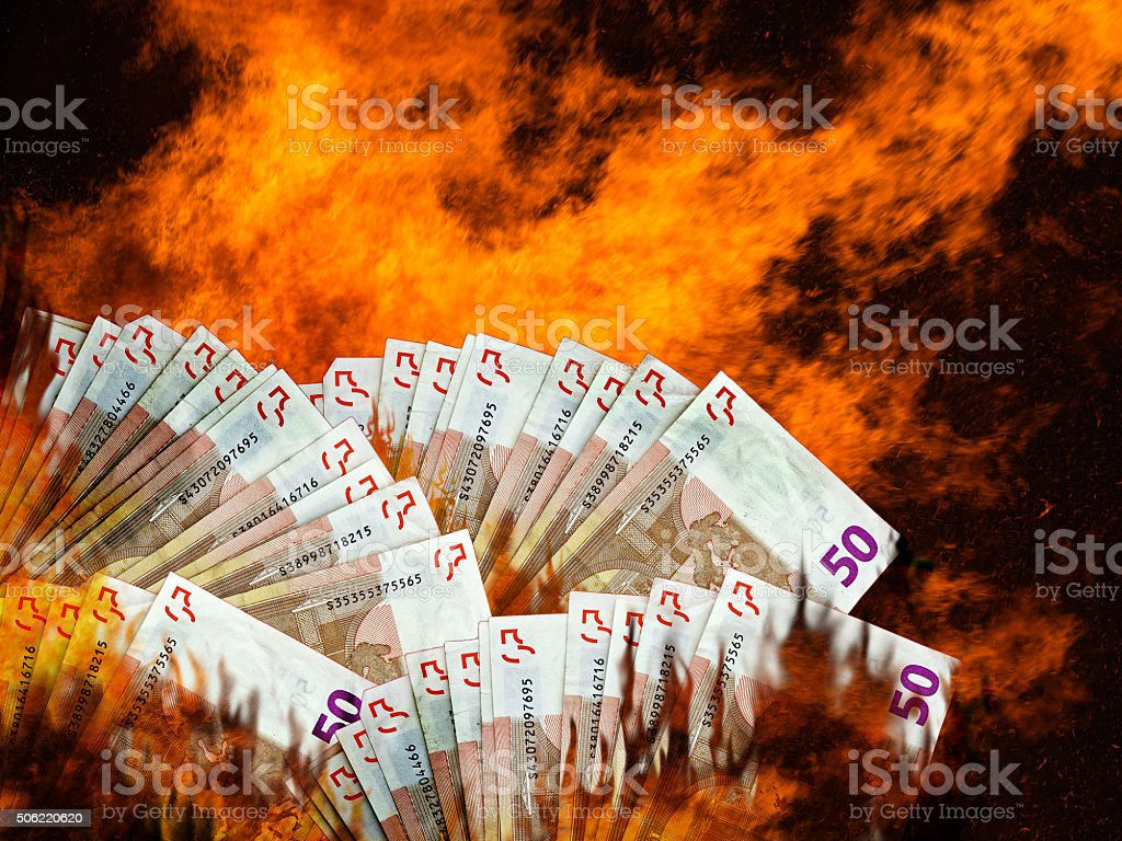 Euro stock market or currency collapse, decline. Money burning. stock photo