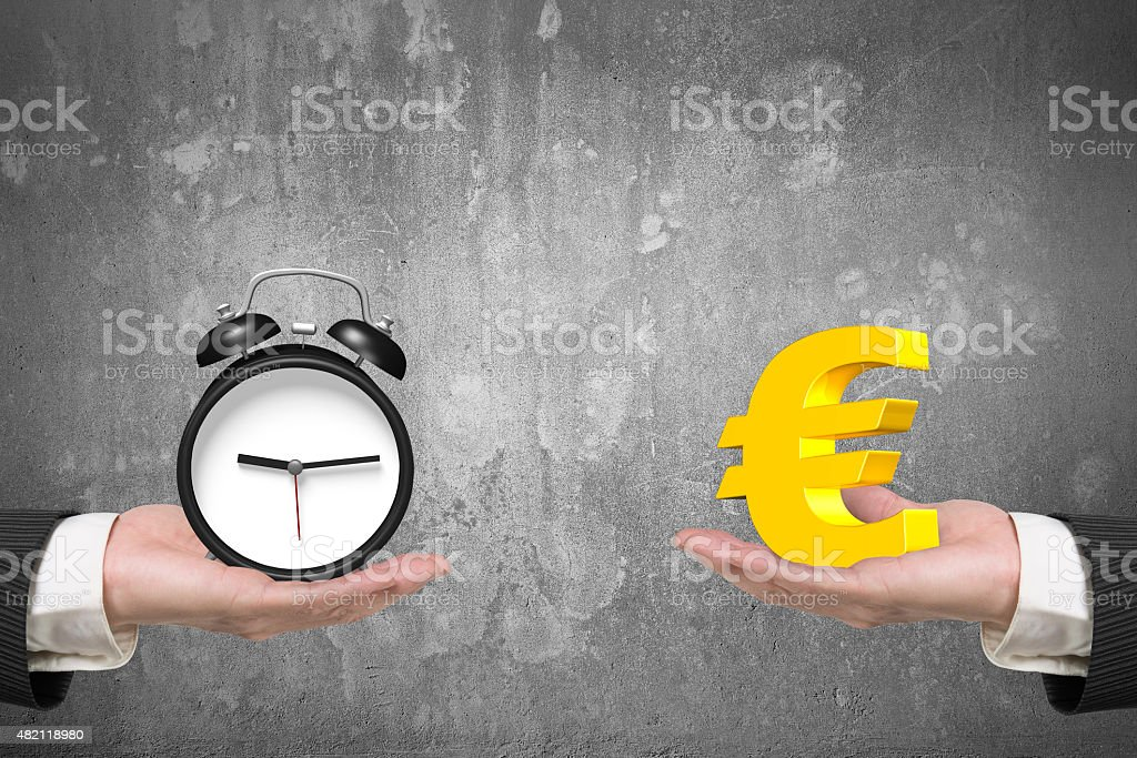 Euro symbol and alarm clock with two hands stock photo