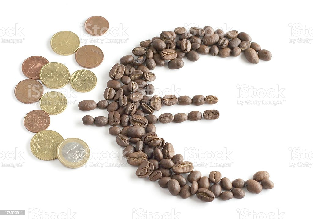 Euro symbol composed from coffee beans and coins royalty-free stock photo