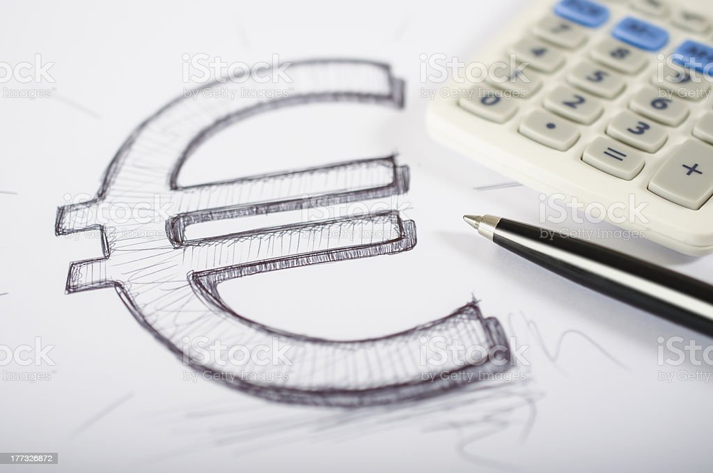 Euro symbol drawn with calculator and ballpoint pen stock photo