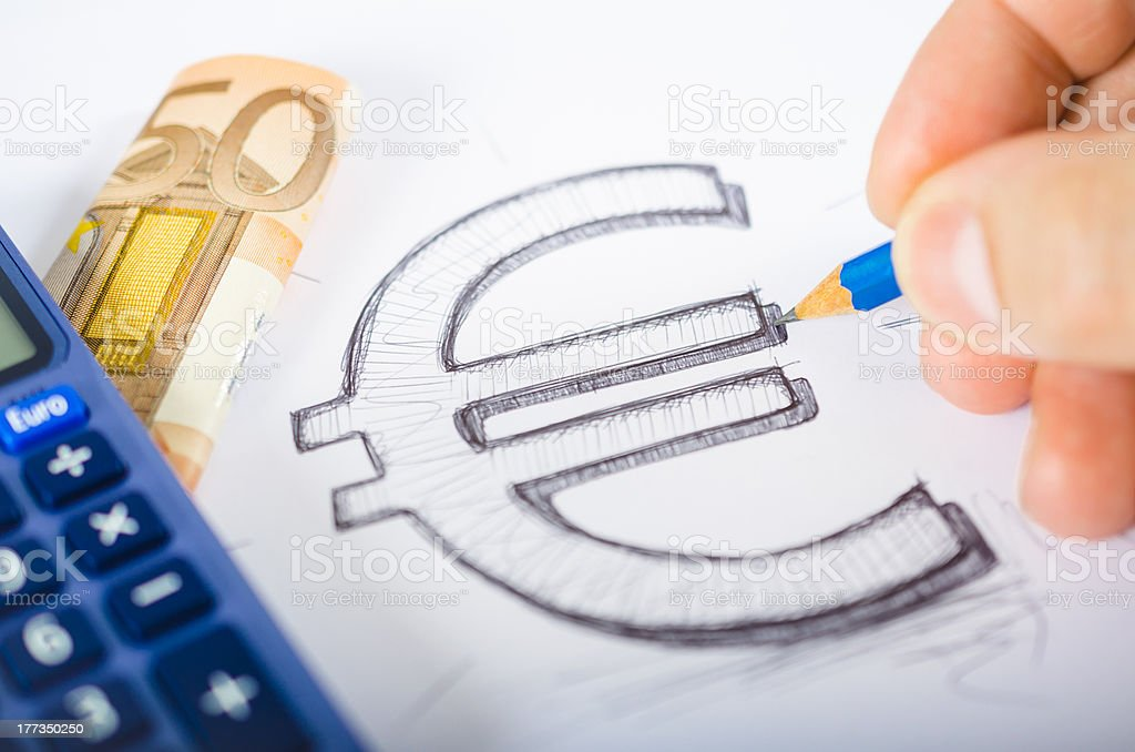 Euro symbol drawn with calculator and banknote stock photo