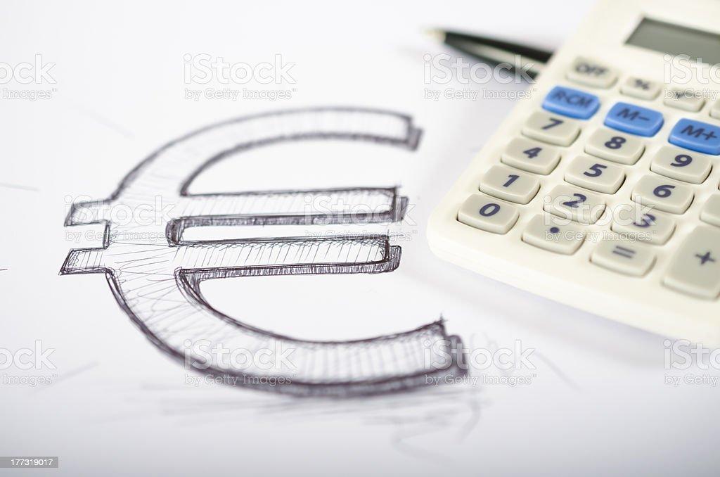 Euro symbol drawn with calculator and pencil stock photo