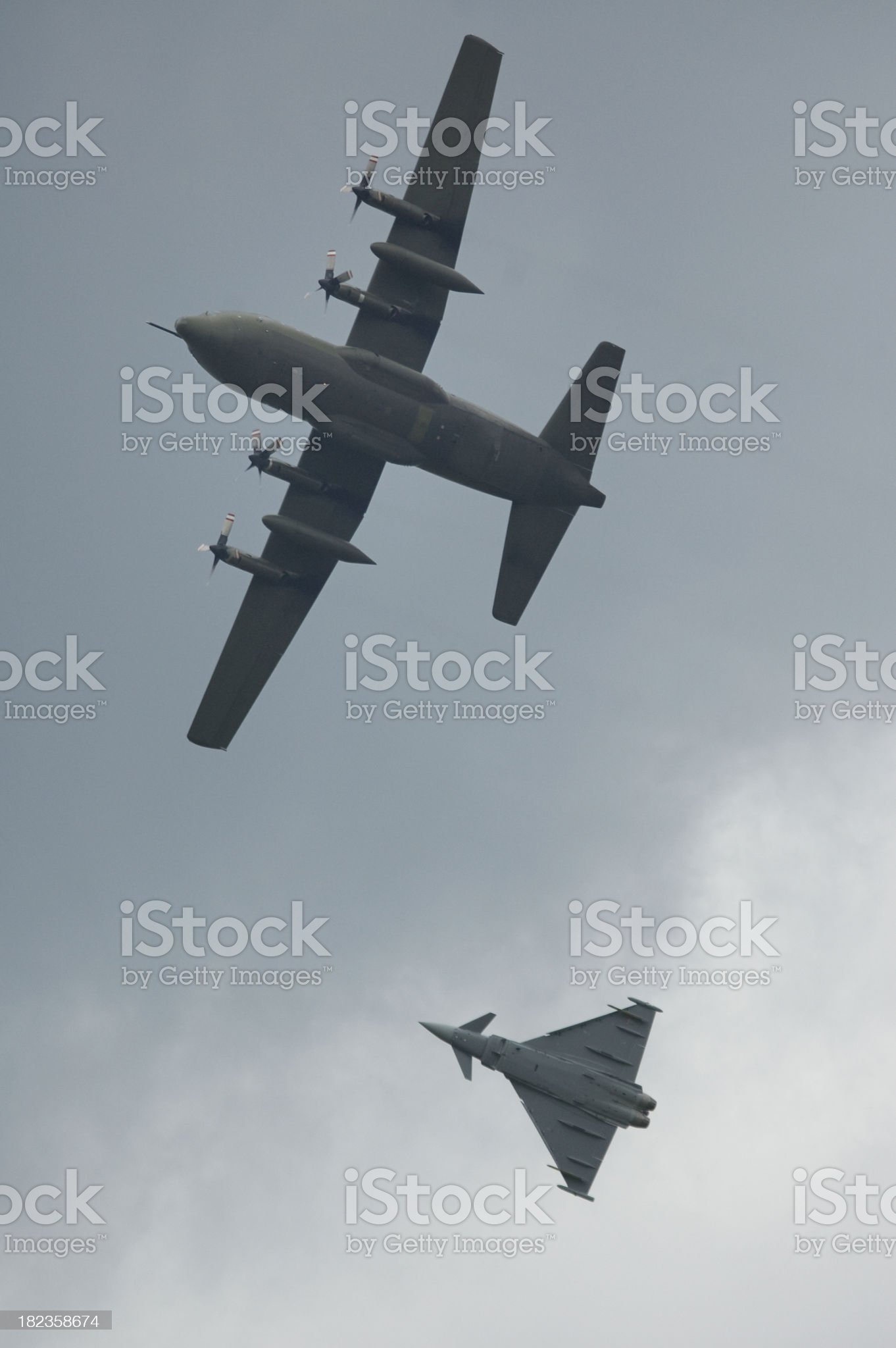 Eurofighter Typhoon with C130 royalty-free stock photo