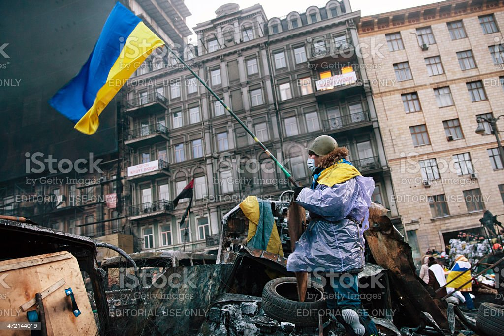 KIEV, UKRAINE - January 26, 2014: Euromaidan protesters rest and royalty-free stock photo