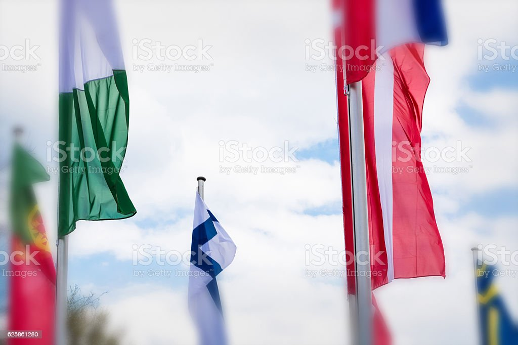 Europe countries flags against a blue sky stock photo