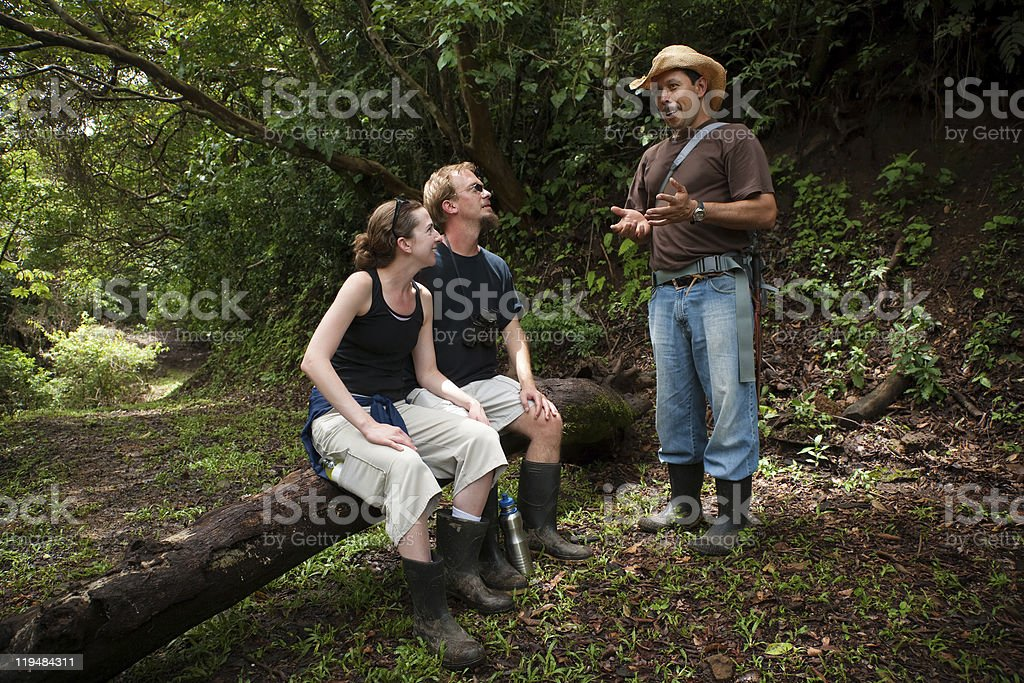 European and American couple with nature guide stock photo