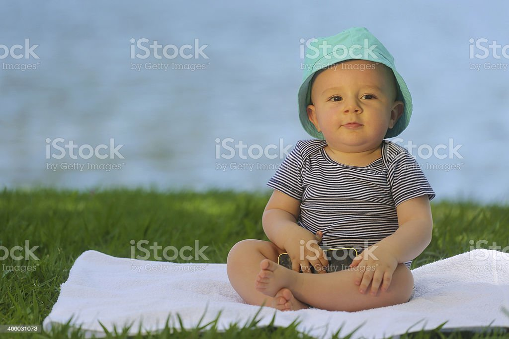 European baby holding a cell phone - 10 month old royalty-free stock photo