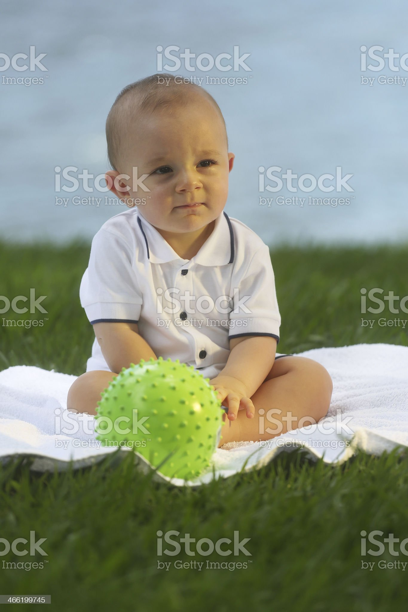 European baby sitting on the grass - 10 month old royalty-free stock photo