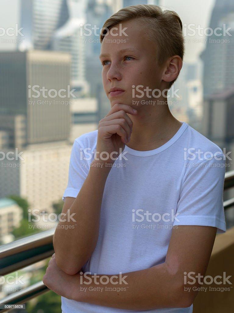 European boy outdoors stock photo