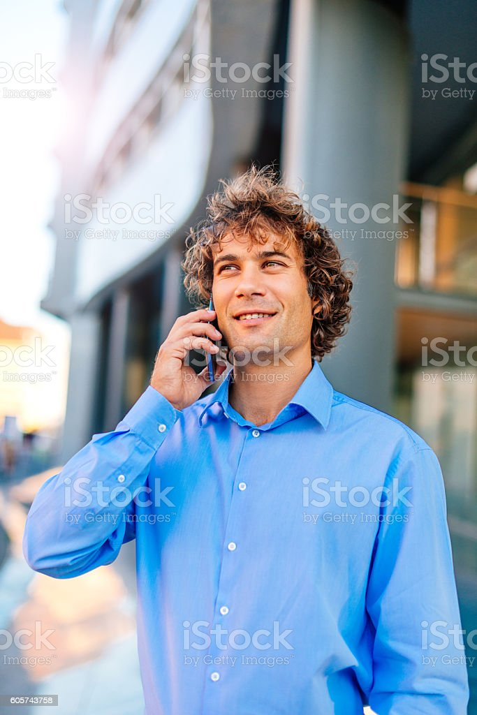 European business person talking on smartphone stock photo