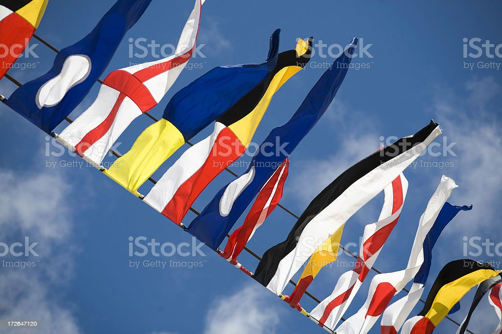 European country flags waving on the sky royalty-free stock photo