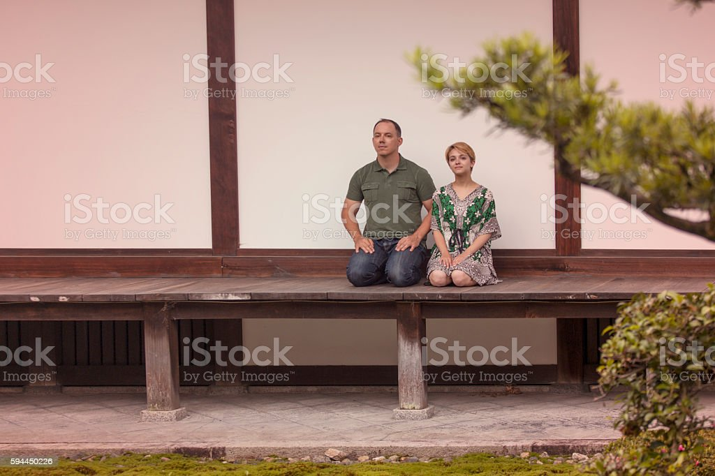 European couple sitting at Hyakumanben Chionji Temple of kyoto japan stock photo