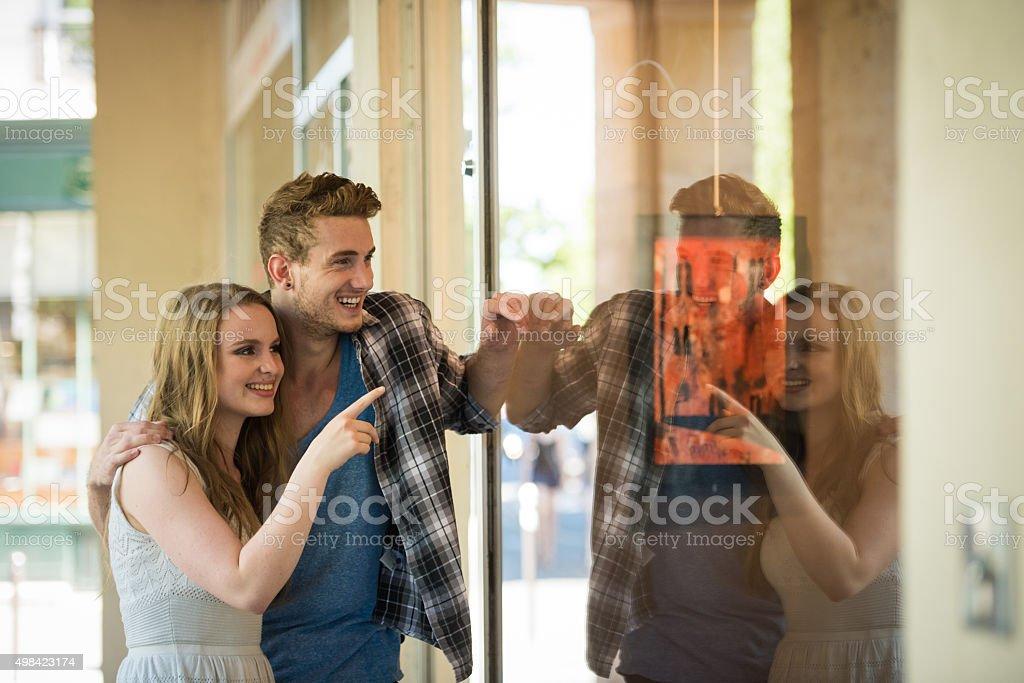 European couple window shopping stock photo