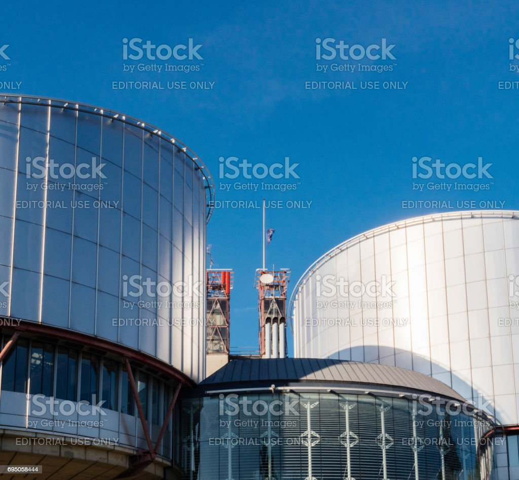 European Court of Human Rights with Half-mast EU flag waving in memory of victims of terrorist attack stock photo