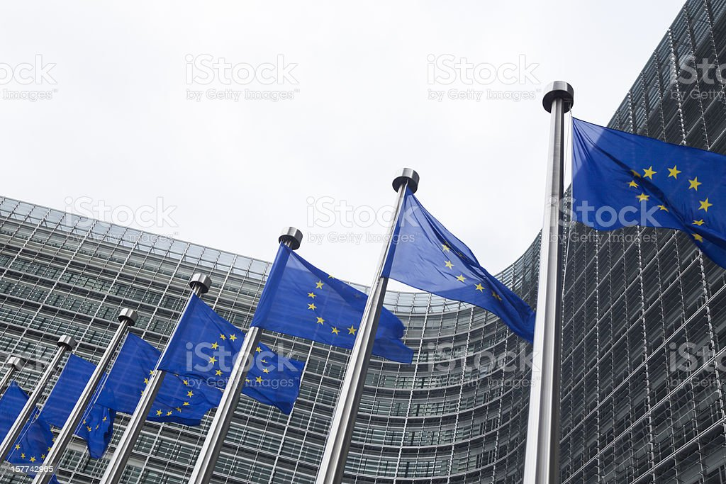 European flags in front of the Berlaymont building in Brussels stock photo