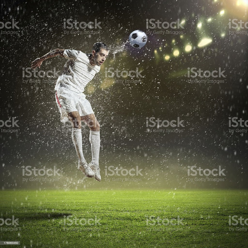 A European football player hitting the ball with his head stock photo