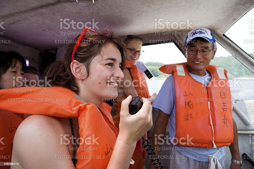 european girls with life vests on motor boat royalty-free stock photo