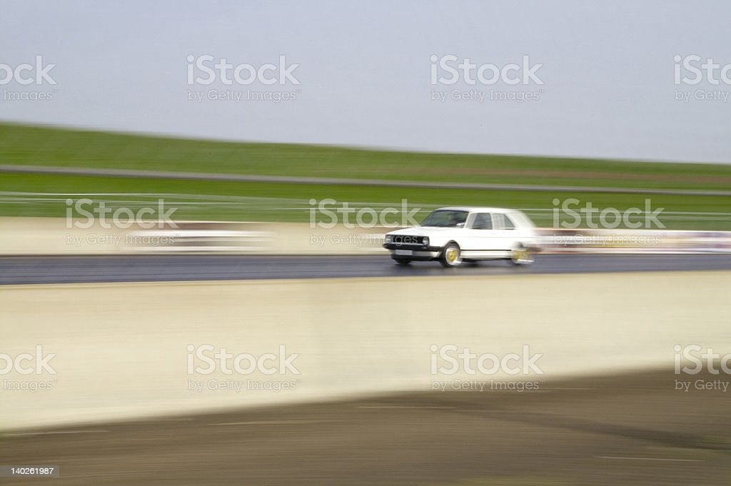 European GTi Car in action on drag strip royalty-free stock photo