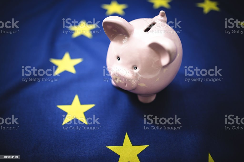 european home finances with piggy bank royalty-free stock photo