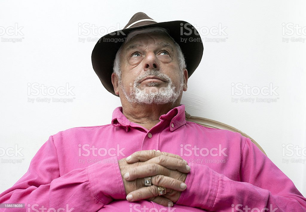 European man clasped his hand and looking up. royalty-free stock photo