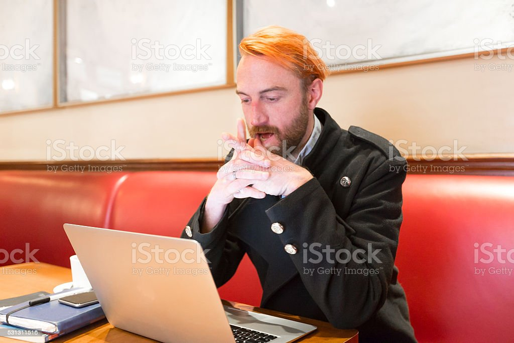 European Man working from a cafe stock photo