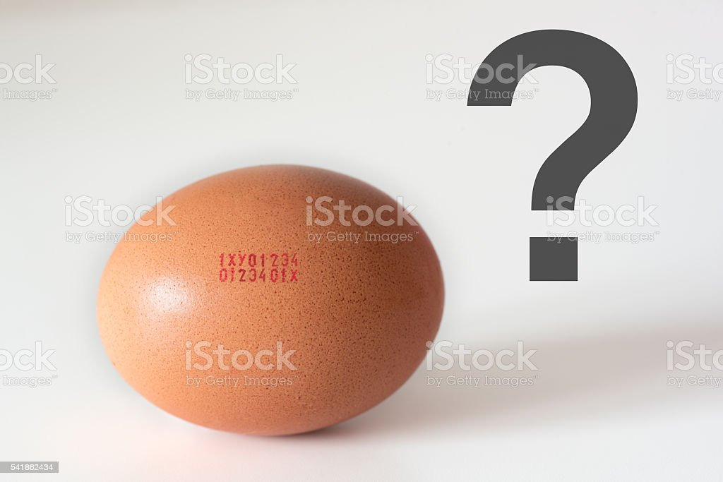 European marking code numbers printed in egg and question mark stock photo