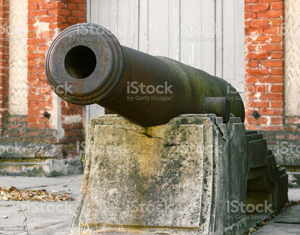 European Medieval iron cannon on concrete stand stock photo