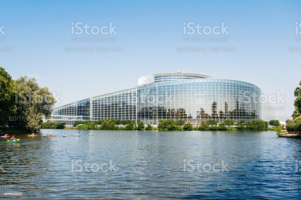 European Parliament in Strasbourg with canoers on blue day stock photo