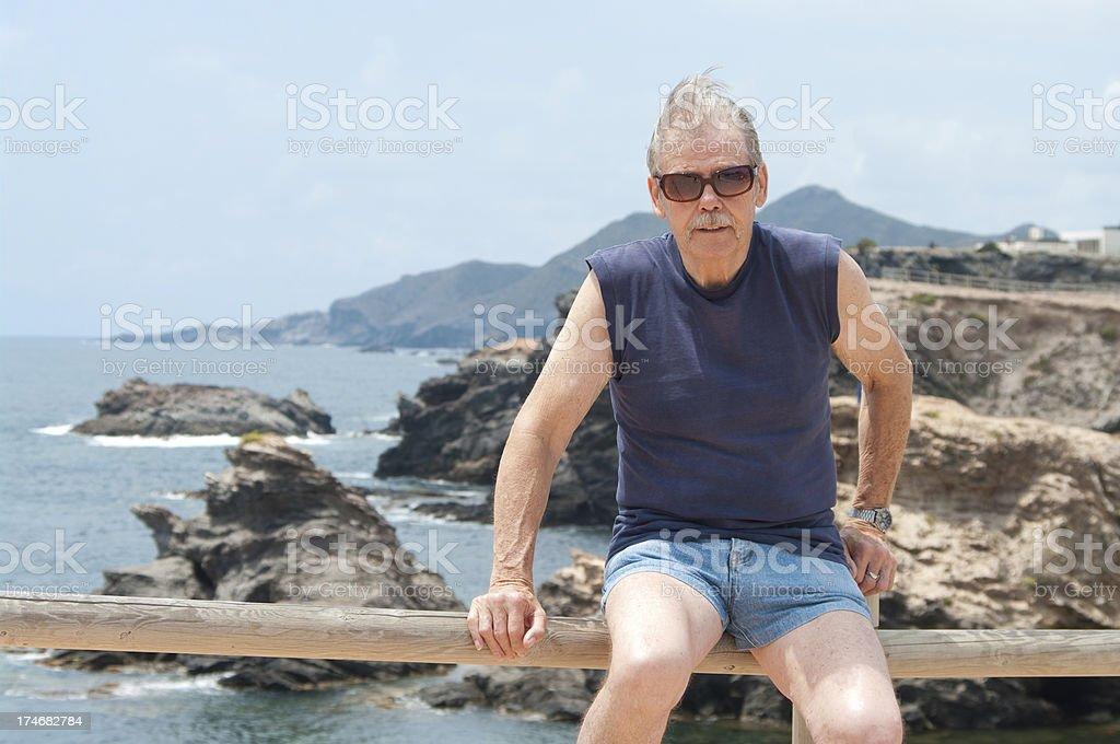 European pensioner man enjoys coastline royalty-free stock photo