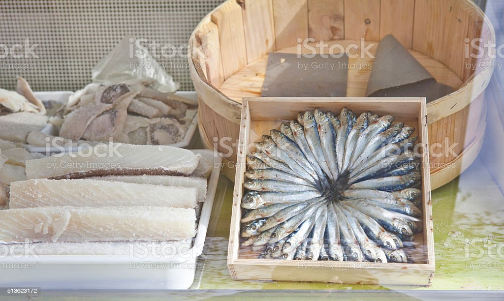 European pilchard and Cod in the fish shop stock photo
