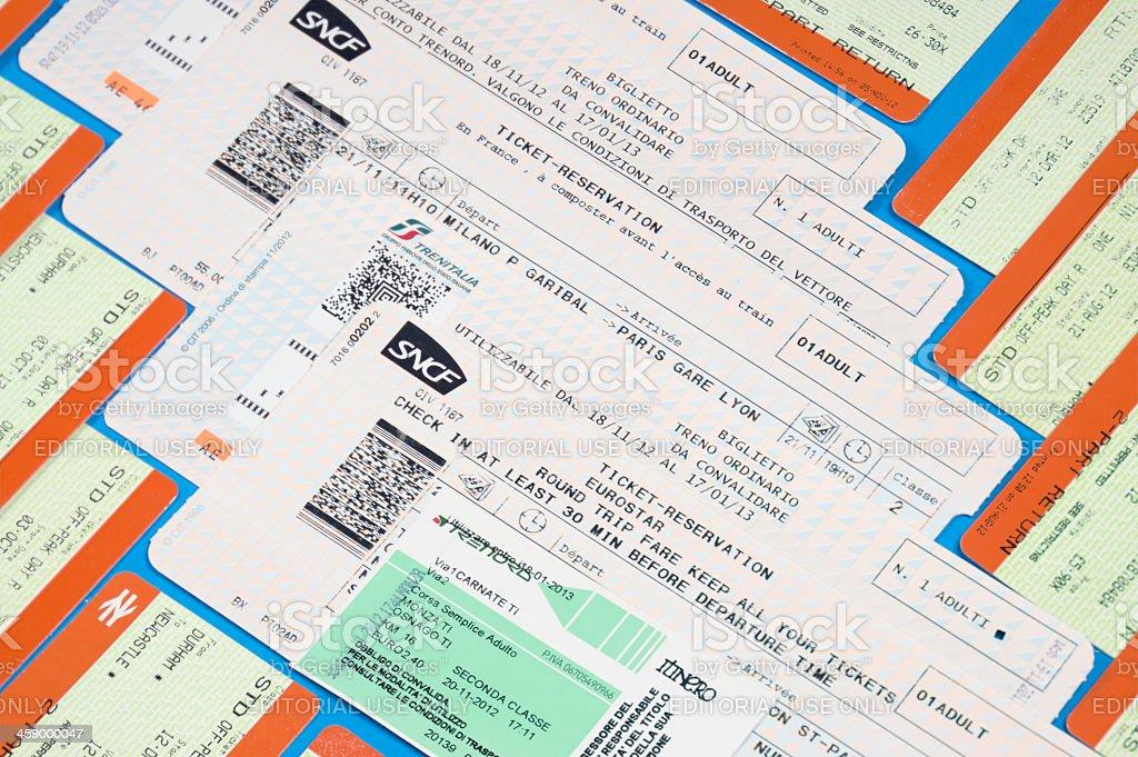 European rail tickets laid on table - Travel background stock photo