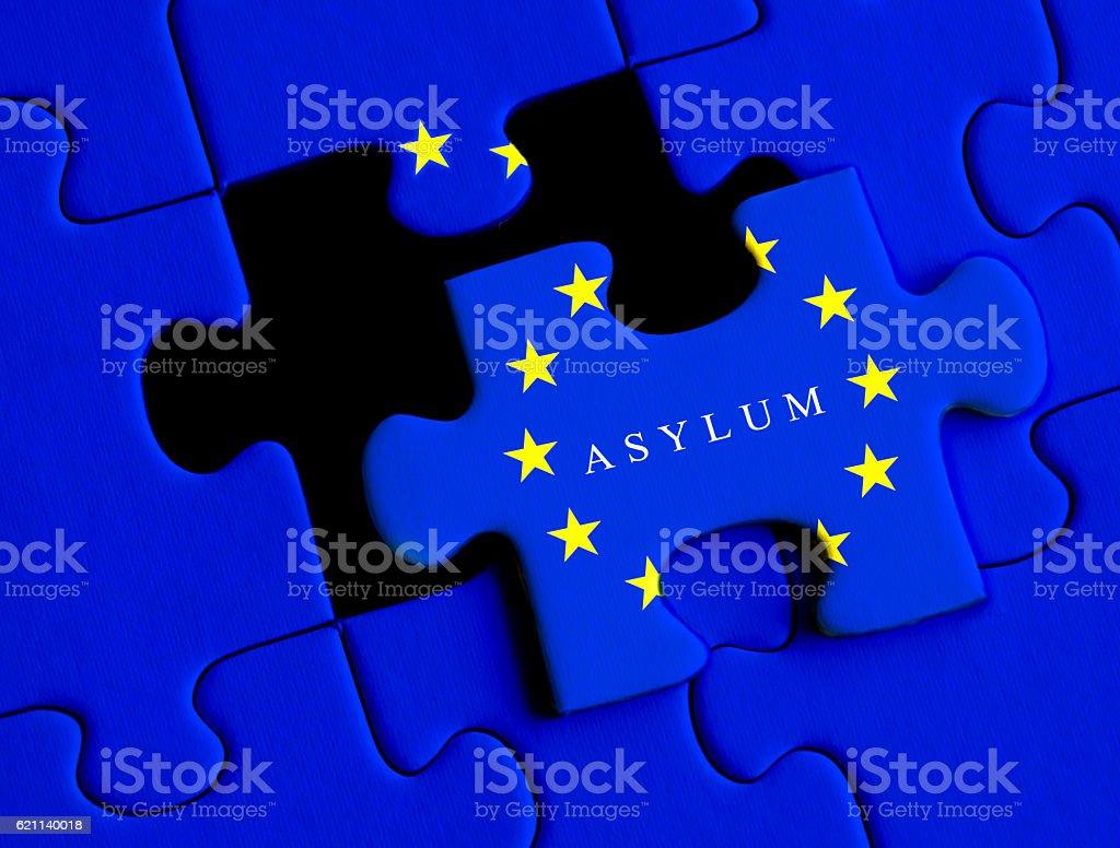 European Refugee crisis. Asylum puzzle concept with European Union flag. stock photo