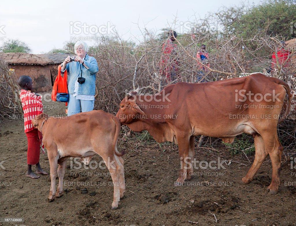 European senior tourist taking pictures in Maasai village. stock photo