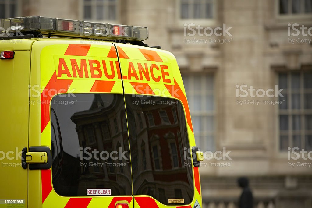 European style ambulance in front of building stock photo