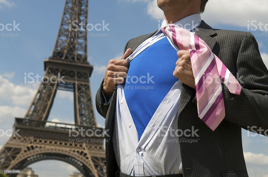 European Superhero Businessman Standing at the Eiffel Tower Paris France royalty-free stock photo