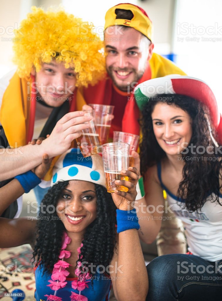 european supporter at home looking the tv stock photo