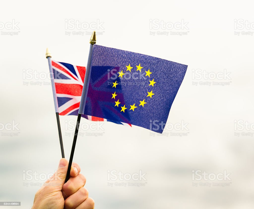 European Union and UK Union Jack flags held together stock photo