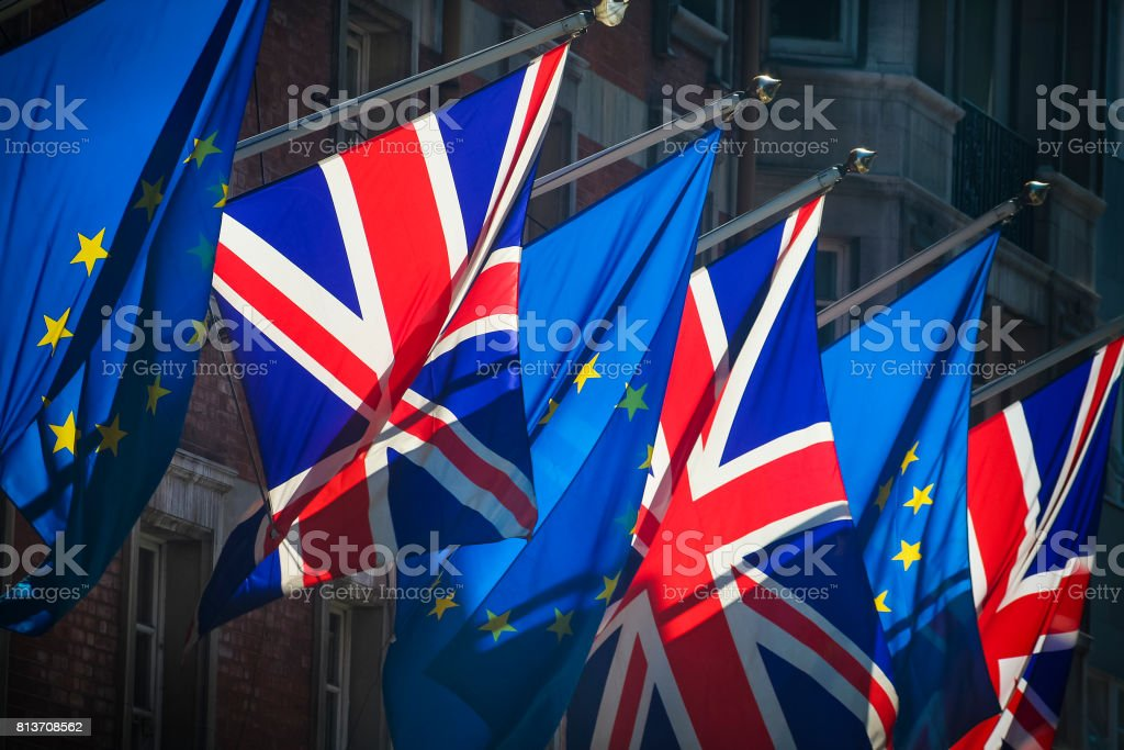 European Union and United Kingdom flags together on sunny day stock photo