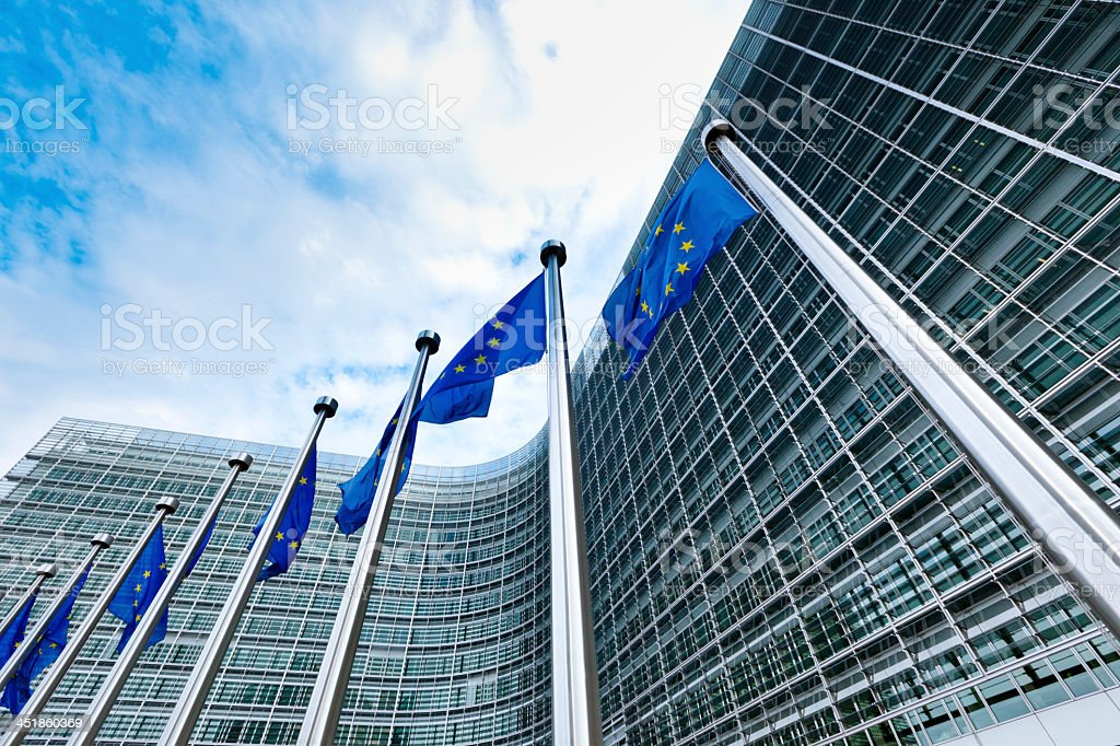 European Union blue and gold flags flying in Brussels stock photo