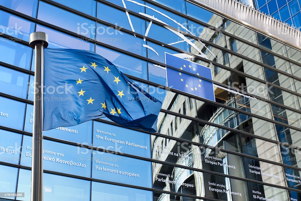 European Union flag against European Parliament stock photo