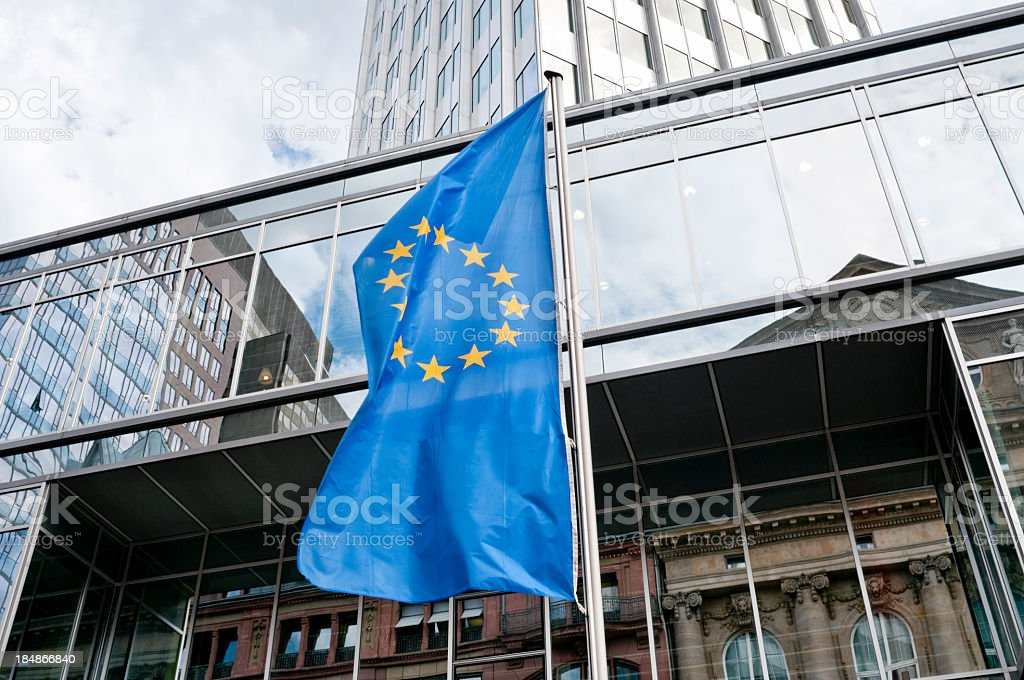 European Union flag in front of the Eurotower in Frankfurt stock photo