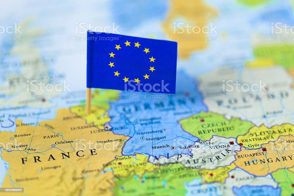 European Union flag over Europe map royalty-free stock photo