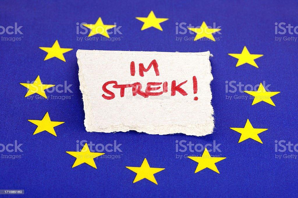 European Union Flag with German On Strike Note royalty-free stock photo