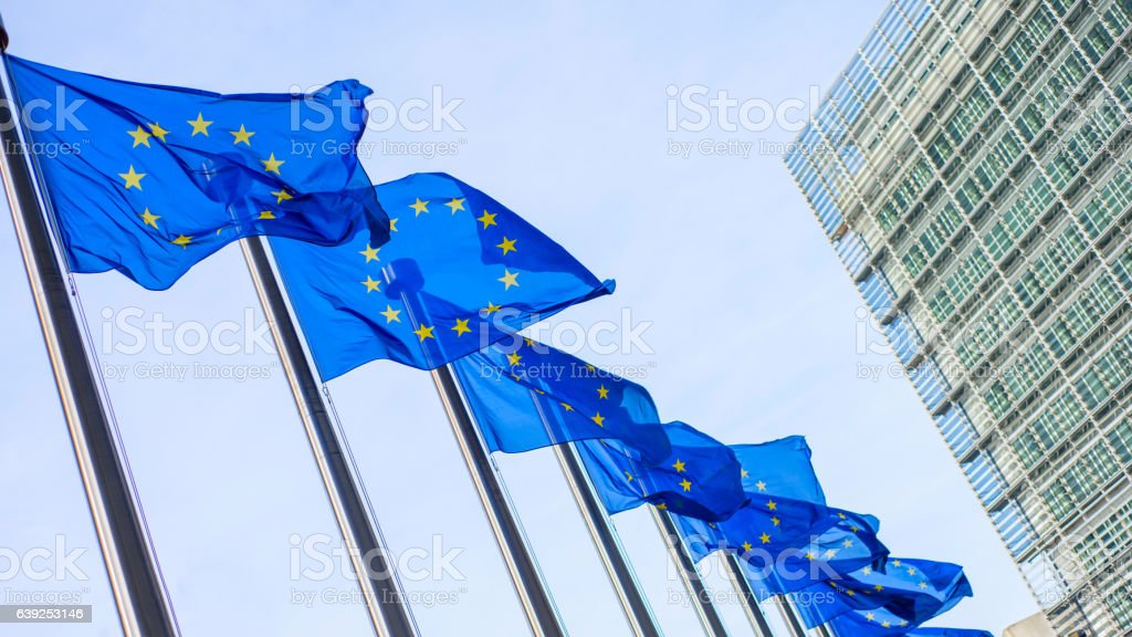 European Union flags in front of the Berlaymont building stock photo