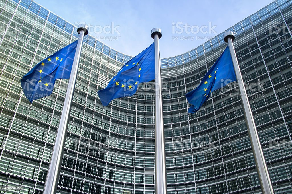 European Union flags near European commission stock photo