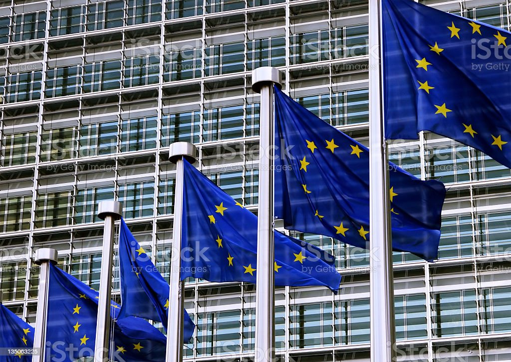 European Union flags next to official building in Brussels royalty-free stock photo