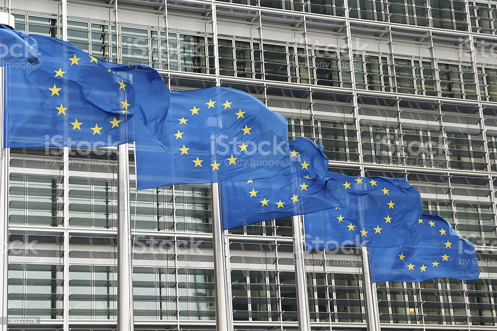 European Union flags outside EU headquarters in Brussels royalty-free stock photo