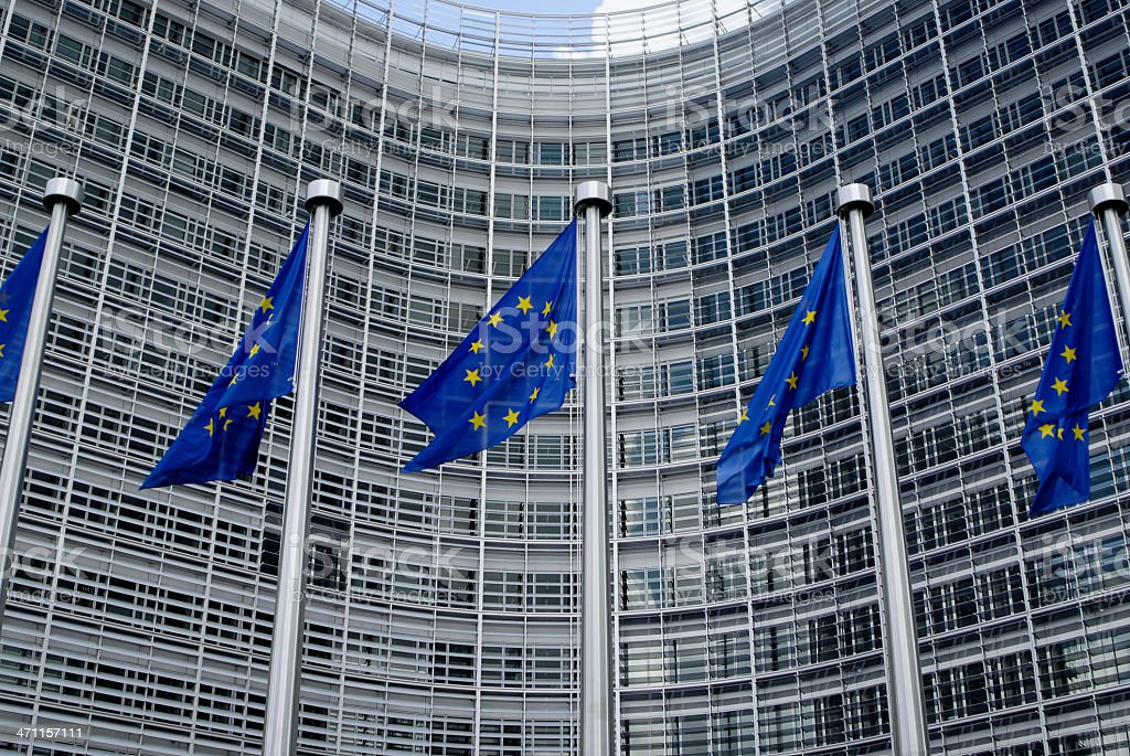 European Union flags outside modern office building royalty-free stock photo